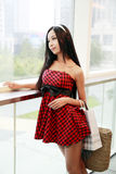 Chinese girl in shopping mall. Royalty Free Stock Image