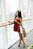 Chinese girl in shopping mall. Chinese girl with shopping bag in shopping mall Stock Photo
