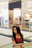 Chinese girl in shopping mall. Royalty Free Stock Photo