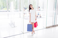Chinese girl in shopping mall Royalty Free Stock Photos