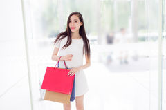 Chinese girl in shopping mall Royalty Free Stock Image