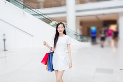 Chinese girl in shopping mall Stock Photos