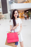 Chinese girl in shopping mall Royalty Free Stock Photography