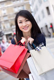 Chinese girl shopping Royalty Free Stock Photos