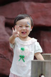 Chinese girl show a gesture Royalty Free Stock Photo