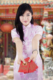 Chinese girl showing envelope in shrine Stock Photos