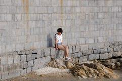 Chinese girl sitting Stock Photo