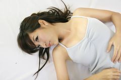 Chinese girl smile. Pretty chinese girl lying down relax royalty free stock image