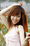 A Chinese girl in summer . Royalty Free Stock Photography