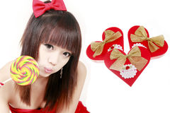 Chinese girl with sweet candy. Happy Chinese girl with sweet candy on white background Stock Images