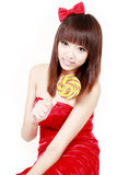 Chinese girl with sweet candy. Happy Chinese girl holding a sweet candy on white background Royalty Free Stock Images