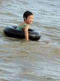 Chinese girl swimming Stock Image