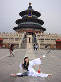 Chinese girl with sword. A Chinese model poses in front of the Temple of Heaven in Beijing, China royalty free stock image