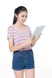 Chinese girl  with tablet Stock Images