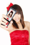 Chinese girl taking self-portrait Royalty Free Stock Images