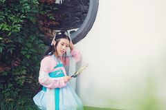Chinese girl in traditional ancient drama costume hanfu cosplay. Chinese beauty in traditional ancient costume, hold a fan on hand, elegant people, Close stock image