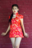 Chinese girl in traditional Chinese cheongsam blessing Stock Image