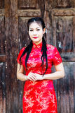 Chinese girl in traditional Chinese cheongsam blessing Stock Photography