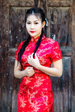Chinese girl in traditional Chinese cheongsam blessing Royalty Free Stock Photos
