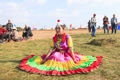 Chinese girl in traditional Chinese clothing during the Heqing Qifeng Pear Flower festival Stock Image