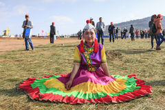 Chinese girl in traditional Chinese clothing during the Heqing Qifeng Pear Flower festival Royalty Free Stock Photography