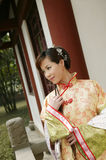 A Chinese girl in traditional dress. A beautiful girl in Chinese ancient dress is in the park Royalty Free Stock Image