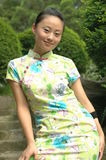 Chinese girl in traditional dress. Chinese girl with kind smile, wearing traditional dress - QiPao Stock Image