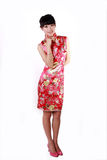 Chinese girl in traditional dress. A Chinese girl in Chinese traditional dress on white Stock Photo