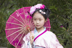 Chinese girl traditional clothes Royalty Free Stock Images