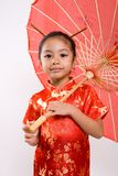 Chinese Girl with umbrella. Chinese girl using chopsticks with a bowl stock images