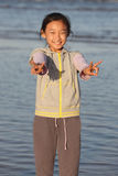 Chinese girl with victory hand signal. The child exhibits the victory the hand signal Stock Image