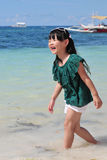 A Chinese girl walking in the sea Royalty Free Stock Photos