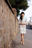 Chinese girl wearing cheongsam Stock Images