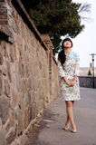 Chinese girl wearing cheongsam Stock Photos