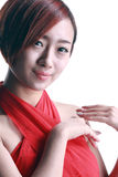 Chinese girl wearing a red dress Royalty Free Stock Images