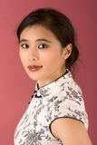 Chinese girl in white cheongsam. Portrait of young beautiful Chinese female in traditional clothes (cheongsam Stock Photo