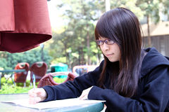 Chinese girl who is reading books Stock Photo
