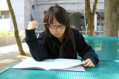 Chinese girl who is reading books Royalty Free Stock Photo