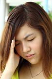 Chinese girl who is sick. She is so painful and has headache Royalty Free Stock Photo