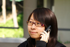 Chinese girl who is talking in phone Royalty Free Stock Photography