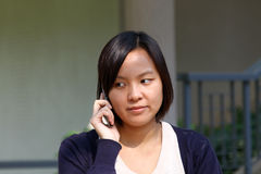Chinese girl who is talking in phone Royalty Free Stock Photo