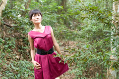 Chinese girl in the wood stock photo