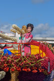 Chinese girl and young man in native clothes on a boat from flowers Stock Images