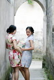 Chinese girlfriends beauty in cheongsam enjoy free time Royalty Free Stock Photo
