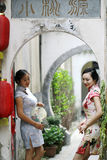 Chinese girlfriends in cheongsam enjoy free time Stock Images