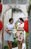 Chinese girlfriends in cheongsam enjoy free time Royalty Free Stock Photography