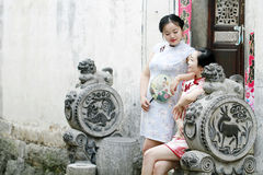 Chinese girlfriends in cheongsam enjoy free time Stock Photography