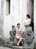 Chinese girlfriends in cheongsam enjoy free time Royalty Free Stock Image