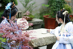 Chinese girlfriends in Hanfu dress drinking tea enjoy free time Stock Photo