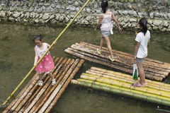 Chinese girls on bamboo raft stock photo